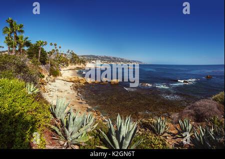 Panoranic view view of the Pacific Ocean at Heisler Park, in Laguna Beach, California, at golden hour - Stock Photo