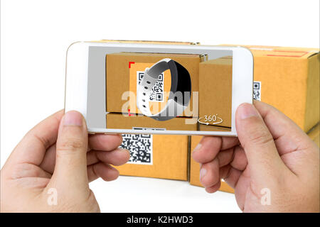 Qr code , Logistic , Augmented reality marketing , X-Ray packages technology concept. Hand using mobile phone to - Stock Photo