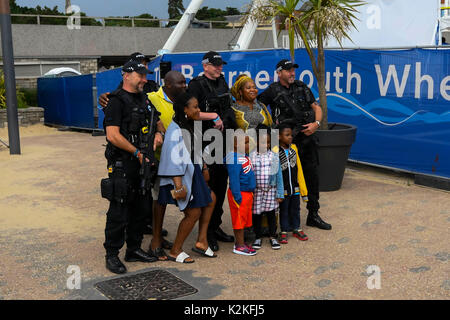 Bournemouth, Dorset, UK. 31st Aug, 2017. Armed Police officers having their pictures taken with visitors at the - Stock Photo
