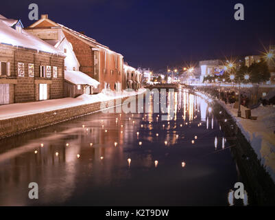 Night illumination at Otaru Canal covered in snow during winter, Otaru, Hokkaido, Japan - Stock Photo