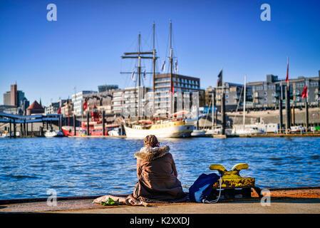 Young woman on a pontoon in the Hamburg harbour, Germany, Europe, Junge Frau auf einem Ponton im Hamburger Hafen, - Stock Photo