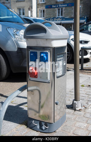 Electric car charging station in the center of Cherbourg in France - Stock Photo