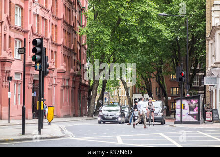 View of Grays Inn Buildings and trees on Rosebery Avenue from Clerkenwell Road, London, UK - Stock Photo
