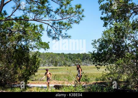 Jekyll Island Georgia barrier island pathway trail Clam Creek Picnic Area girl boy exploring - Stock Photo
