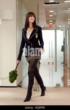 DWP-96 Andy's outfit features a black wool crepe Chanel jacket; Kristina Ti brown tweed mini-skirt; ecru - Stock Photo