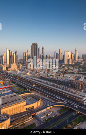 UAE, Dubai, Downtown Dubai, elevated view of skyscrapers on Sheikh Zayed Road from downtown, dawn - Stock Photo
