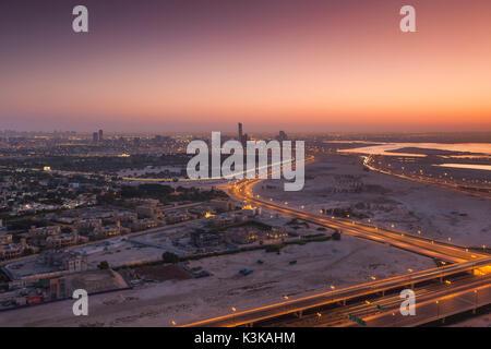 UAE, Dubai, Downtown Dubai, elevated desert and highway view towards Ras Al Khor, dawn - Stock Photo