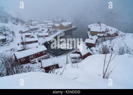 View looking down to snow covered houses in Nusfjord fishing village, Lofoten Islands, Norway - Stock Photo
