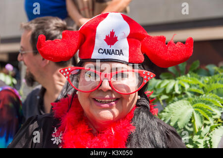 Montreal, CANADA - 20 August 2017: Woman wearing a Moose Antlers Canada Hat at Montreal Gay Pride Parade - Stock Photo