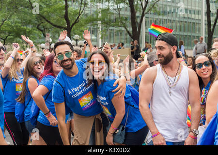 Montreal, CANADA - 20 August 2017: People smiling and posing for the camera at Montreal Gay Pride Parade - Stock Photo