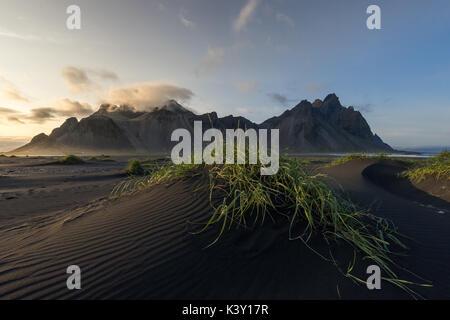 Dunes on Stokksnes beach in front of Vestrahorn mountain, Iceland. - Stock Photo