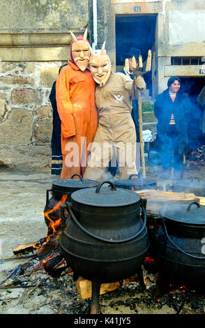 Caretos cooking food for all the people during the carnival in Podence. Tras os Montes, Portugal - Stock Photo