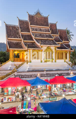 Famous night market and the Haw Pha Bang temple in Luang Prabang, inside the Royal Palace complex, in Laos - Stock Photo