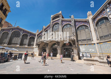 Valencia, Spain - July 27, 2017: Tourist visiting famous landmark Valencia central market on July 26, 2017 in Valencia, - Stock Photo