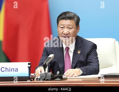Xiamen, China's Fujian Province. 4th Sep, 2017. Chinese President Xi Jinping addresses the ninth BRICS summit in - Stock Photo
