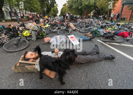 London, UK. 5th Sep, 2017. Stop Killing Cyclists observe a 10 minute silent die-in blocking the Camden Rd at the - Stock Photo