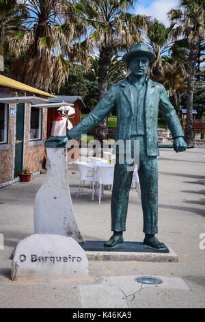 Statue of the boatman (Barqueiro) on the seafront in Vila Baleira, Porto Santo Island, Portugal. Porto Santo Island - Stock Photo