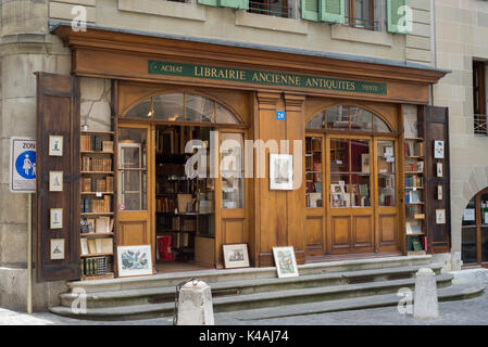 Second hand bookstore with wooden facade, Grand Rue, Old Town, Geneva, Switzerland - Stock Photo
