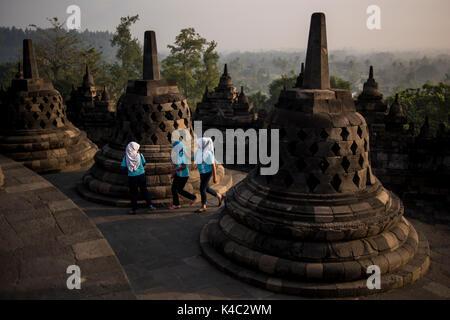 Muslim local tourists at the Borobudur Temple in Java, Indonesia. - Stock Photo