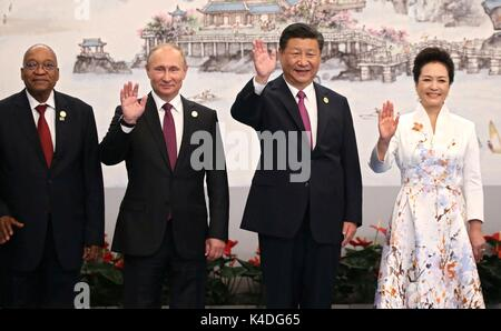 Leaders attending the BRICS Summit wave as they stand for a photo before the start of the official reception September - Stock Photo