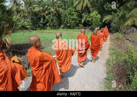 Buddhist monks on morning alms round in Western Cambodia, Indochina, Southeast Asia, Asia - Stock Photo