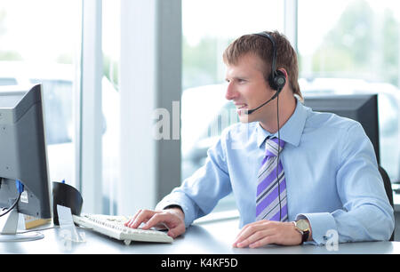 Happy young business man in headphone  smiling. - Stock Photo