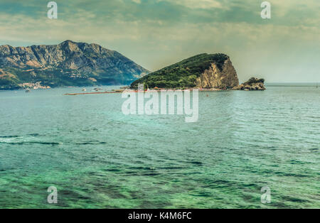 Panorama of the view of the island of St. Nicholas near the town of Budva, a famous tourist resort in Montenegro, - Stock Photo