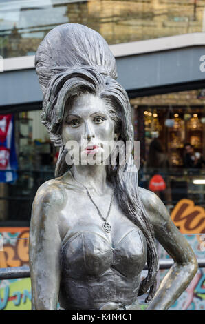 A bronze sculpture of Amy Winehouse in Camden Market in London. - Stock Photo