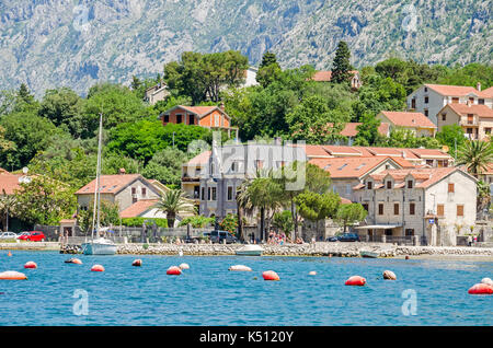 Kotor, Montenegro - June 8, 2017: Dobrota coast of the Bay of Kotor. A part of the waterfront, that consists of - Stock Photo