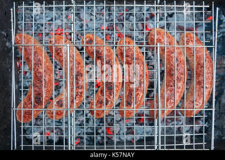 Sausage on grill close up. - Stock Photo