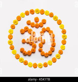 Stock photo of word Aum or om made using marigold flower arrangement - Stock Photo