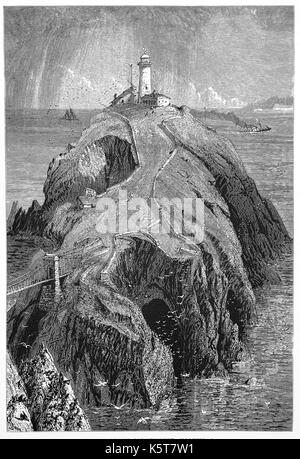1870: The South Stack Lighthouse was built on the summit of a small island off the north-west coast of Holy Island, - Stock Photo