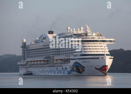 Hamburg, Germany, June 10, 2017 - Crusising Ship Aida Prima is entering the Port of Hamburg in the early daylight - Stock Photo
