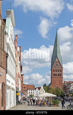 square Am Sande with church of St. John, Lueneburg, Lower Saxony, Germany - Stock Photo