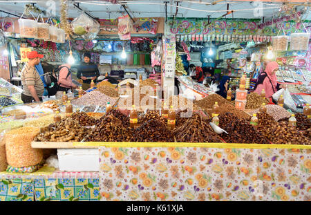 Tiznit. Morocco - December 27, 2016: On local market in Tiznit. Moroccan people buy different products - Stock Photo