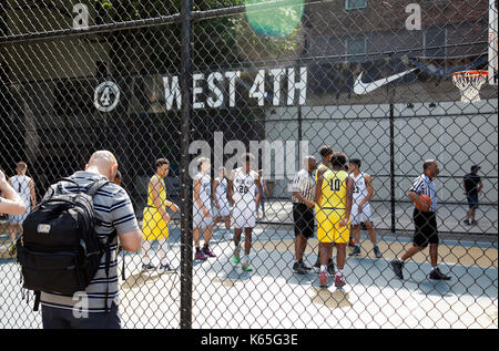 Playing Basketball on West4th street in Greenwich Village, NYC - USA - Stock Photo
