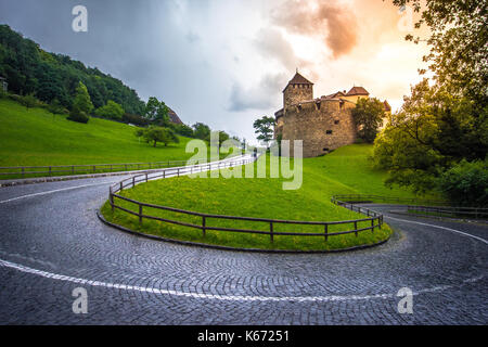 Vaduz Castle, the official residence of the Prince of Liechtenstein, at sunset. - Stock Photo