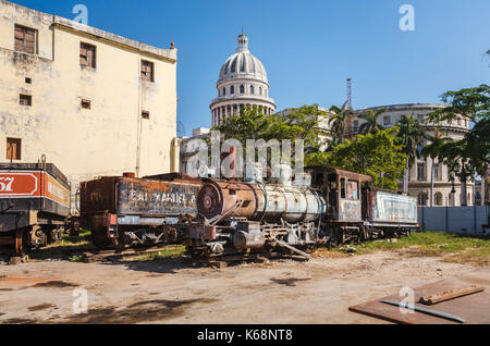 Scrapyard behind the iconic National Capitol Building in downtown Havana, capital of Cuba, with derelict, rusting - Stock Photo