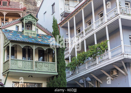 Architectural detail of houses in the centre of Tbilisi, capital city of Georgia. Shows local traditional designs - Stock Photo
