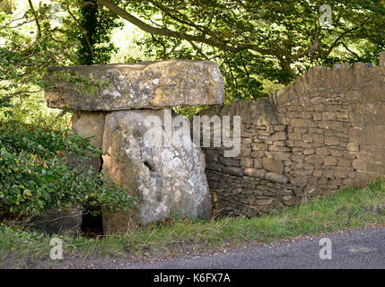 The Three Shire Stones, beside the route of the Fosse Way Roman road, which is now a minor tarmac road heading north - Stock Photo