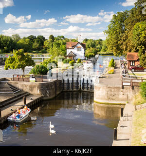 Reading, England, UK - August 29, 2016: The weir and lock on the River Thames at Goring in Berkshire. - Stock Photo