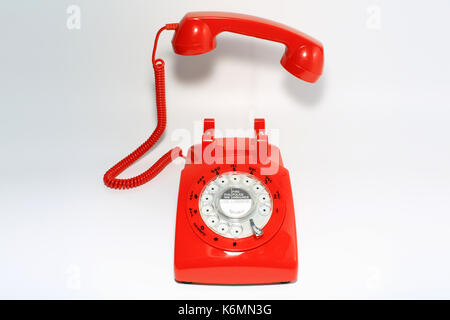 Retro rotary dial phone on call with no body, hang up by hollow man - Stock Photo