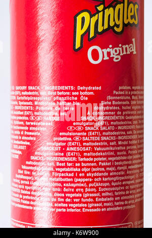 Ingredients and best before information on tub of Pringles Original in many different languages - Stock Photo