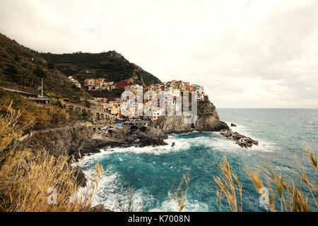 the beautiful pastel colored houses of Manarola, Le Cinque Terre, Italy, from a distance, photoarkive - Stock Photo