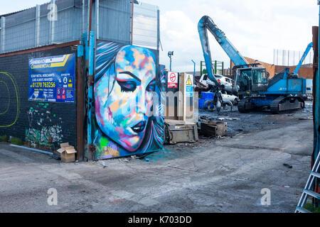 Graffiti on scrap metal merchants doors in Sandbach Cheshire UK - Stock Photo