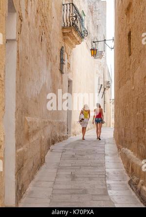 Narrow streets of the historic fortified city of Mdina (Città Vecchia or Città Notabile) in Malta. - Stock Photo