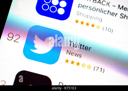 Twitter App in the Apple App Store, App-Icon, display on a screen of a mobile phone, iPhone, iOS, Smartphone, macro - Stock Photo