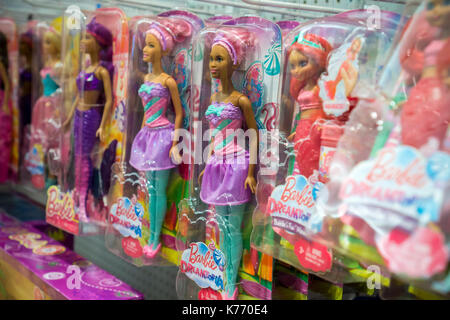 A selection of Mattel Barbie dolls in the temporary Toys R Us location in Times Square in New York on Thursday, - Stock Photo