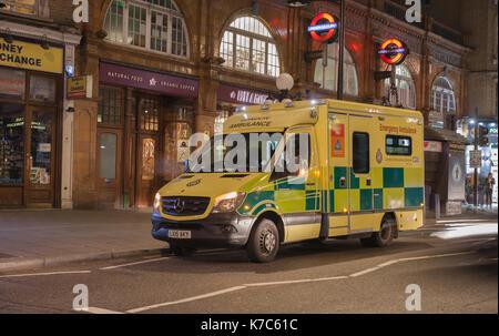Earls Court Tube Station, London - September 6, 2017: London ambulance standing by the tube station Earls Count - Stock Photo