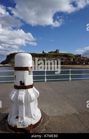 White capstan on harbour wall at Whitby, North Yorkshire. - Stock Photo